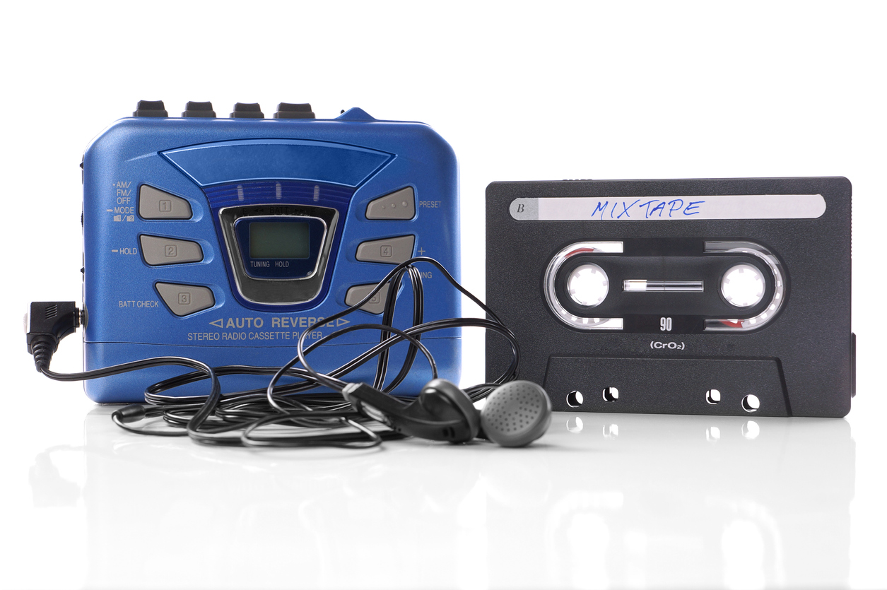 Walkman with earphones and cassette tape