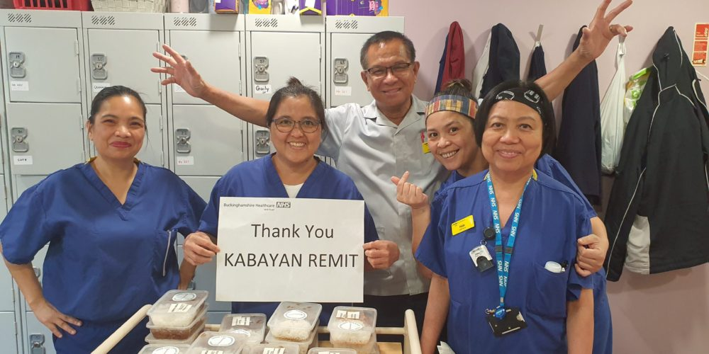 "Nurses happily holding up a ""thank you Kabayan Remit"" sign."
