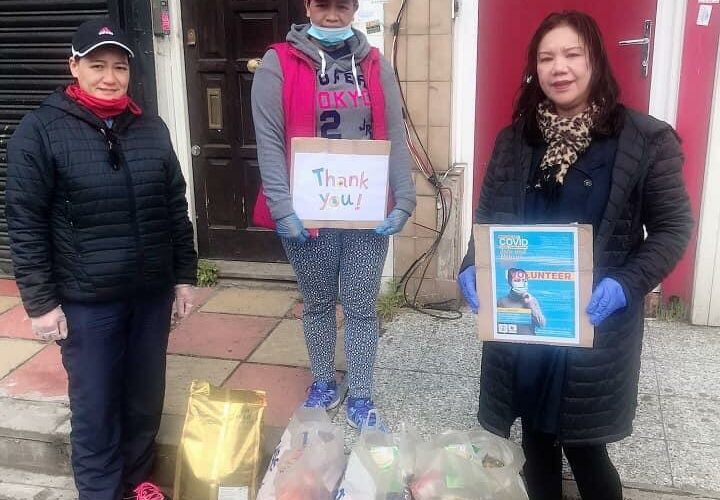 three nurses with bags of food and two nurses holding thank you signs