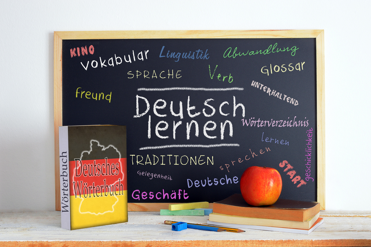 A blackboard full of handwritten German words.
